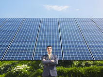 Businessman and solar panels Stock Photos