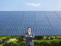Businessman and solar panels Stock Photos