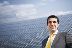 Businessman and solar panels Stock Images