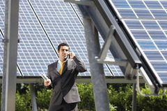 Businessman and solar panels Royalty Free Stock Photo