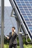 Businessman and solar panels Royalty Free Stock Photos