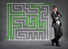 Businessman solved a maze Royalty Free Stock Photo