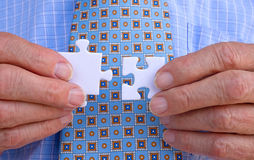 Businessman solving jigsaw Stock Image