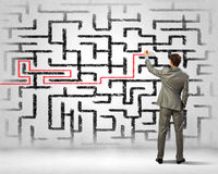 Businessman solving labyrinth problem Royalty Free Stock Photo