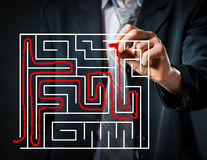 Businessman solving a maze Royalty Free Stock Images