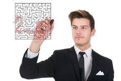Businessman solving maze puzzle on transparent screen Stock Photos