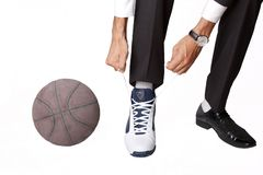 Businessman and some basketball stuff Royalty Free Stock Photos