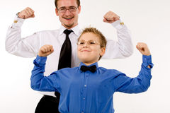 Businessman with son training Stock Photography