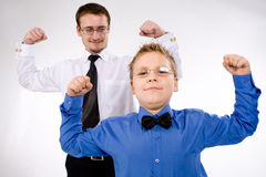 Businessman with son training Stock Image