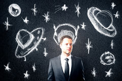 Businessman with space objects Stock Photos