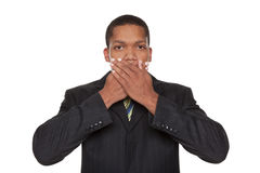 Businessman - speak no evil. Isolated closeup studio shot of a businessman in the Speak No Evil pose Royalty Free Stock Image