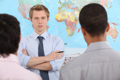 Businessman speaking in front map Stock Photography