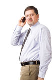 Businessman speaking on his mobile phone Stock Photos