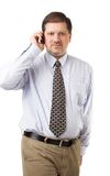 Businessman speaking on his mobile phone Stock Images
