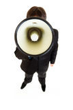 Businessman speaking into megaphone Royalty Free Stock Photos