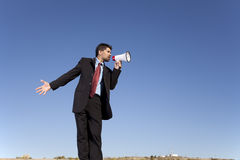 Businessman speaking with a megaphone Royalty Free Stock Photos