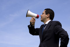 Businessman speaking with a megaphone Stock Images