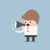 Businessman speaking through megaphone Royalty Free Stock Photo