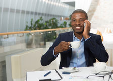 Businessman speaking over mobile phone Royalty Free Stock Photos