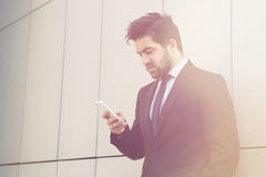 Businessman speaking over mobile phone Royalty Free Stock Image