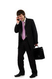 Businessman speaking by phone Stock Image