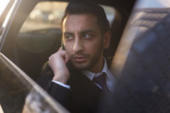 Businessman Speaking by Phone in car Stock Photo