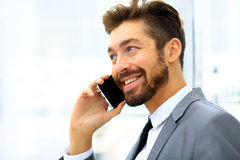 Businessman speaking on the phone in office Royalty Free Stock Image