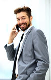 Businessman speaking on the phone in office Royalty Free Stock Photos