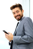 Businessman speaking on the phone in office Royalty Free Stock Images