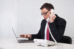 Businessman speaking on phone Royalty Free Stock Photography