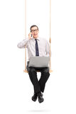 Businessman speaking on phone and swinging Stock Photo