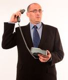 Businessman speaking to angry customer Royalty Free Stock Photography