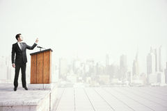 Businessman speaking from tribune Stock Photography