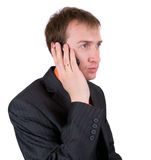 The businessman speaks by a mobile phone Royalty Free Stock Photos