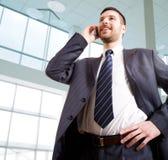 Businessman speaks by phone. Modern businessman speaks by phone stock photo