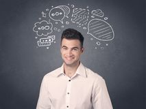 Businessman with speech bubbles. Young casual businessman with drawn speech bubbles over his head Royalty Free Stock Photography