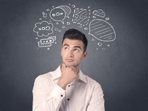 Businessman with speech bubbles. Young casual businessman with drawn speech bubbles over his head Stock Photos