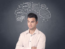 Businessman with speech bubbles Royalty Free Stock Photography