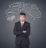 Businessman with speech bubbles Royalty Free Stock Photo