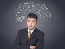 Businessman with speech bubbles Royalty Free Stock Photos