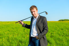 Businessman spends his free time playing golf. Young businessman spends his free time playing golf Royalty Free Stock Photography