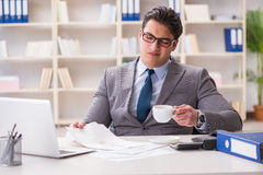 The businessman spilling coffee on important documents Stock Photo