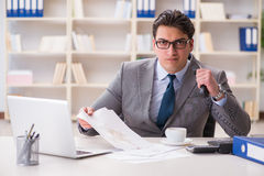 The businessman spilling coffee on important documents Royalty Free Stock Images