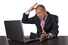 Businessman spilling coffee on laptop isolated on white background stock image