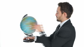 Businessman spinning a globe Stock Photo