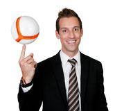 Businessman spinning soccer ball Stock Photo