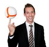 Businessman spinning soccer ball Stock Photo