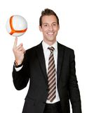 Businessman spinning soccer ball Stock Photos