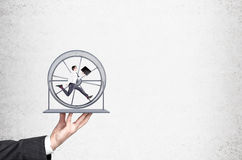 Businessman in spinning wheel Royalty Free Stock Photography