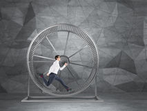 Businessman in spinning wheel Royalty Free Stock Photos